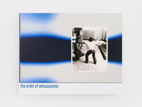 "An abstract composition of blue, black, and white printed on dibond, appearing like a lava lamp. ""the other of sensuousness"" is printed in blue on the bottom-left of the dibond. There is a black and white photograph glued to the dibond of a young boy swinging his hips to the right, seen from behind."