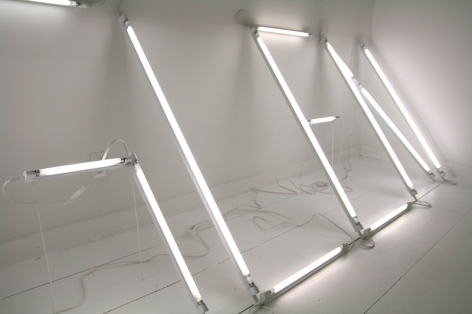 """An image of """"G-L-E-N"""" written in white neon tubes"""