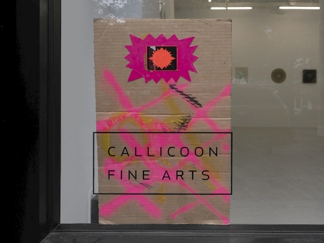 """A piece of cardboard painted with pink X's, that also has a small fuchsia starburst at the top of the piece. It is placed the """"Callicoon Fine Arts"""" logo in the gallery's front window."""