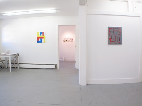 An image of 2 works (one in the main room at left, one in the hallway at right) and 3 more are visible through a doorway in the background
