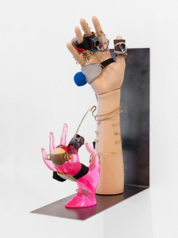 A steel shelf that holds 2 mannequin hands (one wood, one pink plastic) that are outfitted with muffs and gaffs