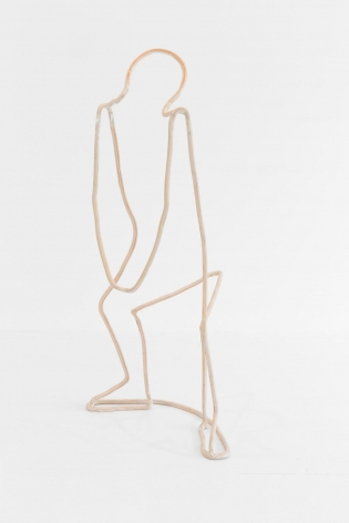 A plywood sculpture that is meant to look like a single carved line. The line describes a silhouette of a figure lifting, with knees bent and arms down.