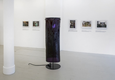 Installation view of a sculpture by Ajay Kurian and 5 photographs by Jiri Skala of factory machines