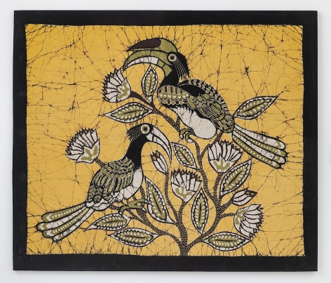 A textile with a black border; three hornbill birds are gathered in the middle of a yellow background. They are green, black, yellow, and white in color, very graphic