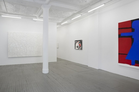 A photograph of the back quadrant of the gallery, which includes one large painting on the back wall that is predominantly white, a smaller work at right, and an excerpt in the foreground at right.