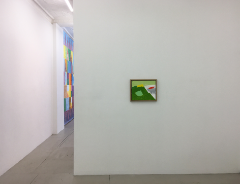 Installation view of an Etel Adnan painting on a wall in the foreground, with a sight-line that leads to the next room and Colter Jacobsen's painting