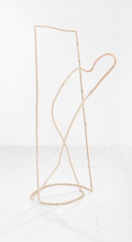 A standing sculpture of an abstract human silhouette, peeking it's head out of a tall square. Made of plywood to resemble a single line