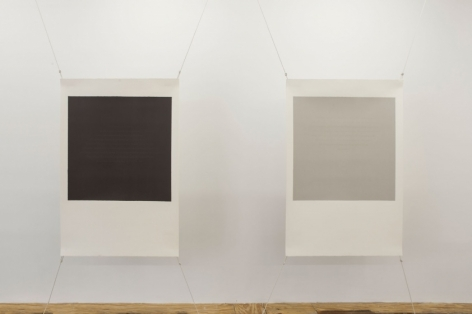 A view of 2 screenprints by Bergvall stretched at four corners with wire. On the left, the center is black with a white border; at right the center is gray with a white border.