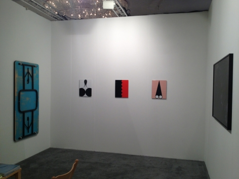 A view of the inside of the booth, with 3 enamel paintings on the far wall, and one Tongue Depressor by James Hoff