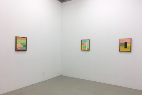 An installation view of 3 Etel Adnan paintings, framed in pine wood