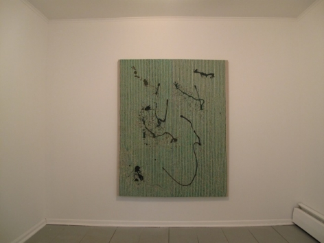A photograph of an abstract green work with dark splotches/lines