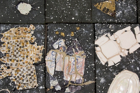 A detail of printed decals applied to Kahlil Robert Irving's large floor sculpture: tessellated images of fried chicken, a decomposted Vess soda bottle, a flattened styrofoam clamshell made out of ceramic, a cracked serving plate, specks of gold