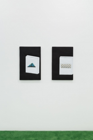 A photograph of two small works next to each other with abstracted cigarette cartons on a black background.