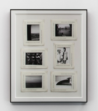 6 small photographs enclosed within a black frame