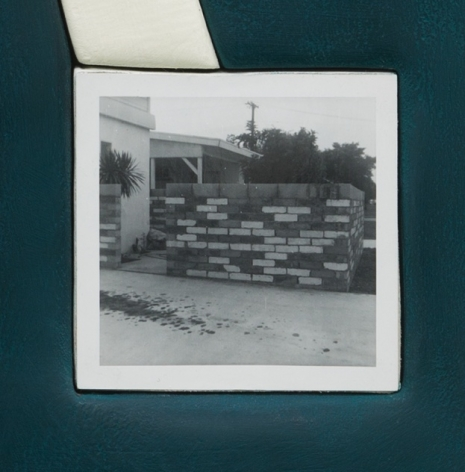 A detail photograph that depicts the square photograph on the surface of the artwork. The photograph depicts a brick wall with multiple colored bricks, in black and white.