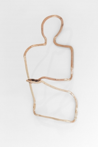 A plywood sculpture that is meant to look like a single carved line. The line describes a silhouette of a figure, installed on the wall, with a handful of pennies.
