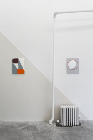 A photograph of 2 enamel paintings, one on a gray wall, one on a white wall. A diagonal separates the 2 and defines the space.