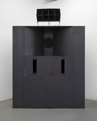 A photograph of the speaker component of this sculpture. It is painted black and functions as the speaker in the room.