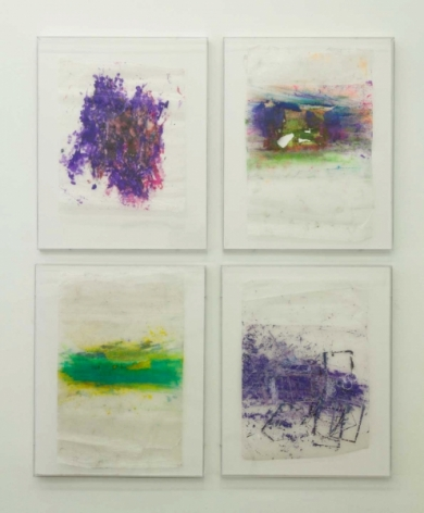 A photograph of four colored drawings on wax paper, framed, arranged in a square.