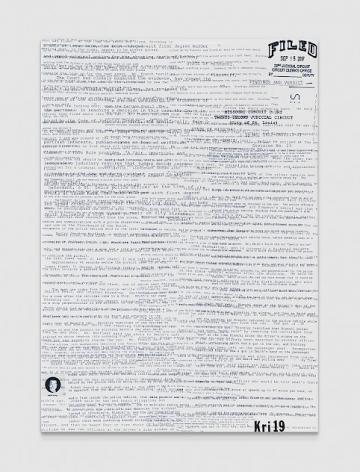 A white industrial ceramic tile with text printed onto the surface, collaged, almost illegible