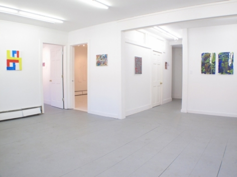 A photograph of the main gallery with 6 works in and around the main room, with 2 open doorways at left