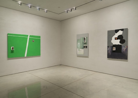 A photograph of 3 works installed at Mary Boone Gallery.