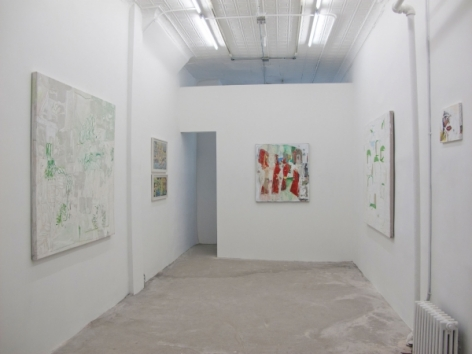 A photograph of the gallery with 6 abstract works on 3 walls