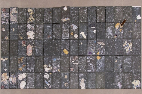 Aerial view of the large floor sculpture by Kahlil Robert Irving, made up of 80 black clay ceramic tiles with varied inserts and decals