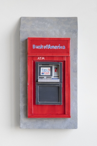 A Bank of America exterior ATM sculpted out of foam and paper, installed on the wall. The ATM itself is depicted on a gray stone wall.