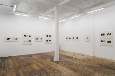 A wide photograph of the gallery that depicts 21 images across 2 walls.