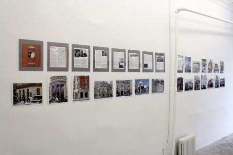 A photograph of 2 rows of photographs of bank facades, unframed