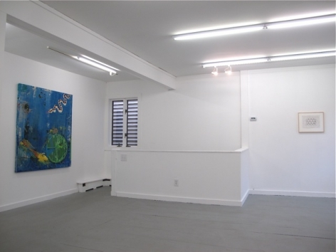 A photograph of the gallery with a large blue painting on the wall at left, and an abstract black and white drawing in the background