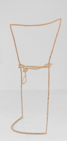 A standing sculpture that resembles a tall rectangle with a rope tied around the center, made of plywood that resembles a single line