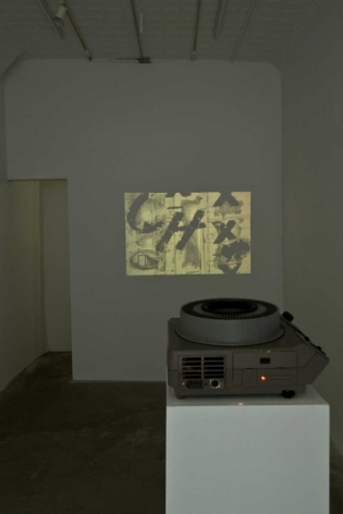 An image of the film with it's projector on a white pedestal