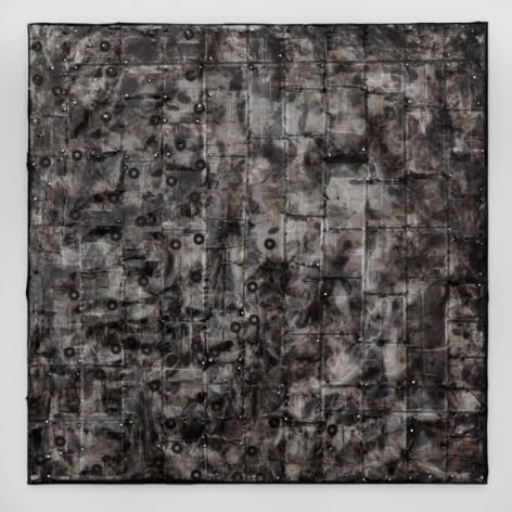 A square artwork that contains film negatives effected by black and white coloration due to paint and nail polish.