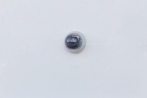 A photograph of the small surveillance camera used for Kovachevich's projection. This camera is facing outward to the street.