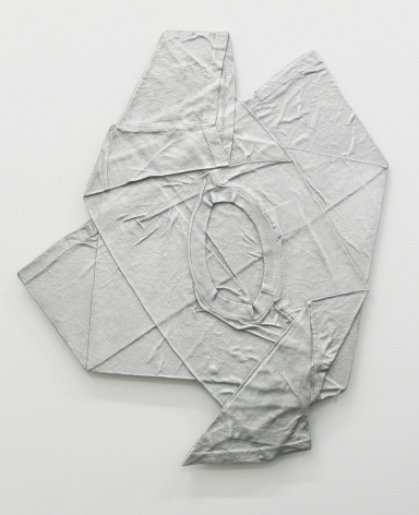 A flattened tshirt, made of aluminum