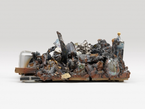 A ceramic sculpture that includes a multitude of tromp-l'eoil vessels and styrofoam clamshells in addition to masses of stone, varied lusters and decals.