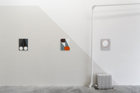 3 enamel paintings hung on the wall. 2 are on a grey wall, 1 at right is on a white wall.