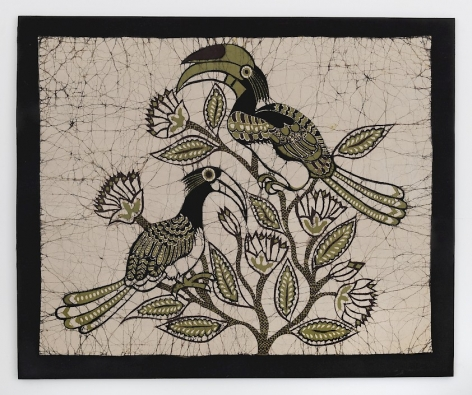 A textile with a black border; three hornbill birds are gathered in the middle of a beige background. They are green, black, and white in color, very graphic