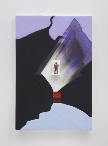 A photograph of an artwork that is mostly black, with a photograph of a figure in the center. There seems to be light surrounding the figure, and a small red square beneath it. There is some purple in near the top of the piece that is painted and collaged on.