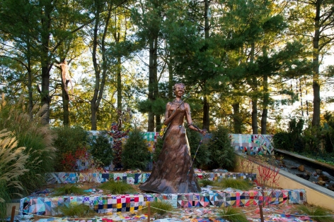 Araminta With Rifle And Vèvè,2017, installation ofJoyce J. Scott: Harriet Tubman and Other Truths, Grounds for Sculpture, Hamilton Township, NJ (October 22, 2017 -April 1,2018)