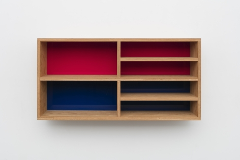 Donald Judd's Untitled plywood piece with red and blue acrylic sheets from 1992, measuring 20 x 40 x 10 in. (50.8 x 101.6 x 25.4 cm)
