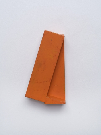 Joel Shapiro's untitled small red wall sculpture, c. 1978-80, made of wood and paint, 7 7/8 x 4 1/4 x 2 3/8 in. (20 x 10.8 x 6 cm).