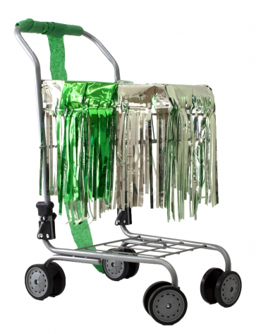 Holly Harrell  Nooks, 2020  Small Shopping cart, fringe skirt, deflated balloon, crepe paper streamer  16 x 22 x 12 inches