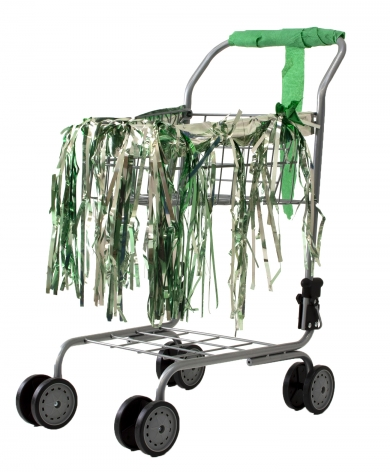 Holly Harrell  Crannies, 2020  Small Shopping cart, fringe skirt, deflated balloon, crepe paper streamer  16 x 22 x 12 inches