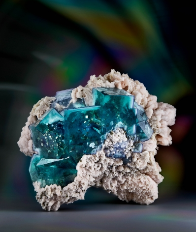 Fluorite with Pyrite Inclusions on Manganocalcite