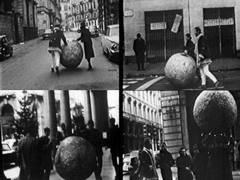 Pistoletto newspaper ball performance