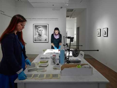 2 women processing artist archives on table
