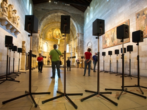 Circle of speakers set up inside The Cloisters